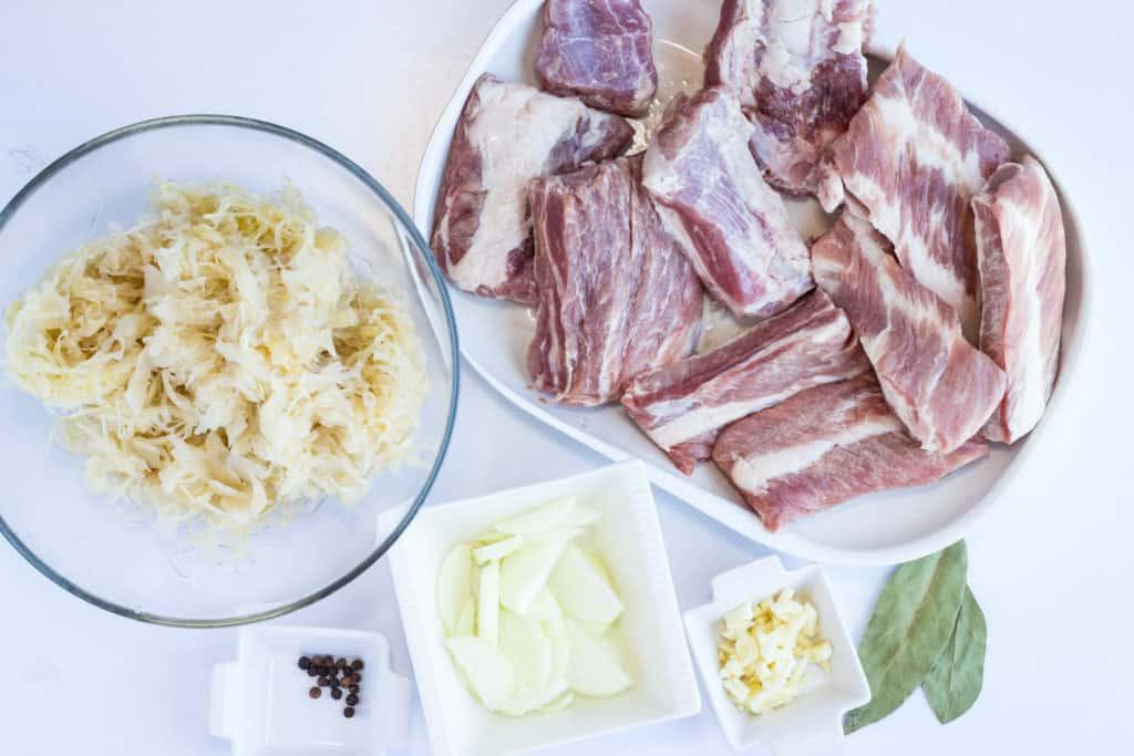 ribs, onion, garlic, sauerkraut and spices to make keto ribs and sauerkraut