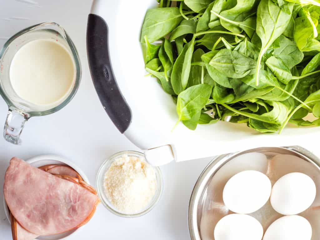 Spinach, ham, eggs, cream, parmesan - ingredients in Baked Eggs Florentine with Ham
