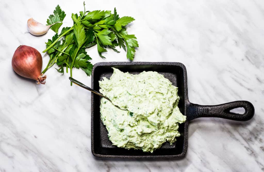 Green Goddess Dip in a square cast iron dish.