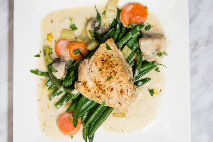 creamy country chicken on a plate with green beans