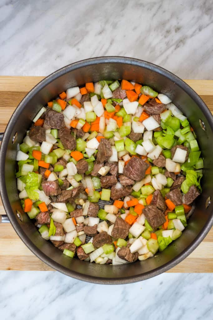 all veggies and beef into a soup pot