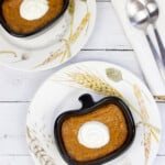 ketp pumpkin custard in a ramekin on a plate with spoons