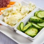 Keto Cauliflower Pickles on a plater with cucumbers, cheese and salami