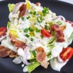 keto wedge salad on a black plate